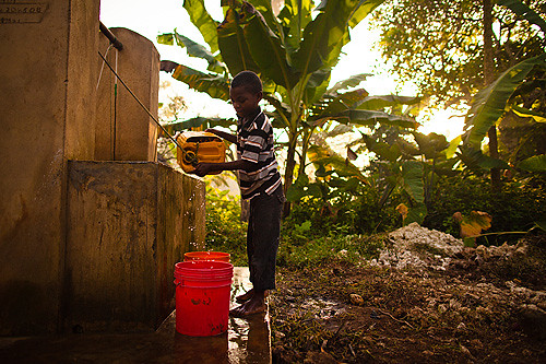 Zakia's son fetching water at the well near their house
