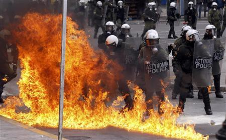 Greek riot police battle demonstrators in downtown Athens during rebellions against the imposition of a new round of austerity measures in the European state. The world capitalist crisis has swept through Europe causing great destruction. by Pan-African News Wire File Photos