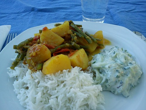 curried potatoes and green beans with rice and cucumber raita