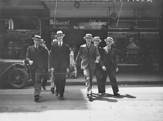 Seven men modelling hats in Pitt Street, for City Hatters, 1 November 1934, by Ernie Bowen