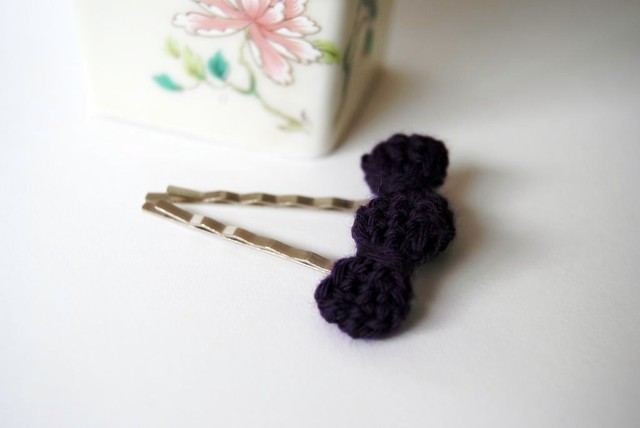 Bobby pins with purple crocheted bow