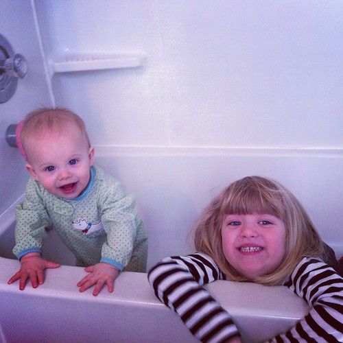Catie thought it would be funny to get in the empty tub with her clothes on. Lucy agreed. Goofy kids.