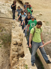 A group of students, headed by Andrew Hostetter, cross an ancient aqueduct built by Herod the Great