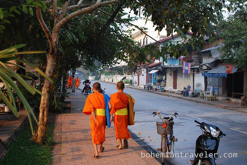 novice monks walking in Luang Prabang