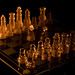 chess board lit by oil lamp