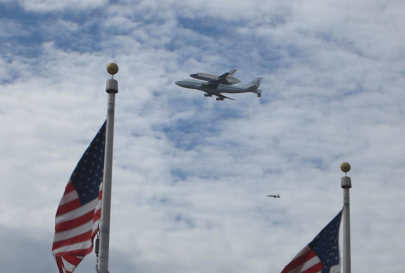 Space shuttle Discovery over National Mall