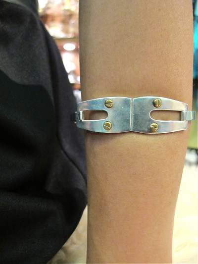 Love! This is a 1970s-80s Cartier inspired love bangle. It's Mexican silver with brass screws.