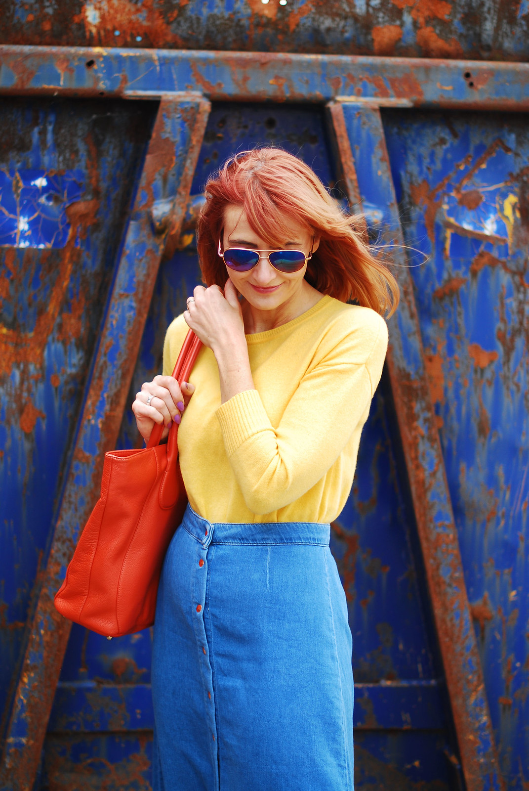 Primary brights colour blocking: Yellow sweater, denim midi skirt, orange tote bag, | Not Dressed As Lamb