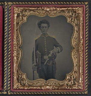 [Unidentified soldier in Union cavalry uniform with Savage revolver and sword] (LOC)
