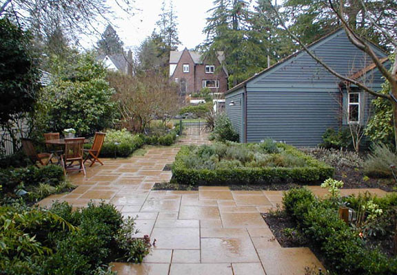 Stone tiles offer transition from driveway throught the entrance terrace.