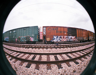 Lomography Fish Eye - My friend Alex and I in the train yard.