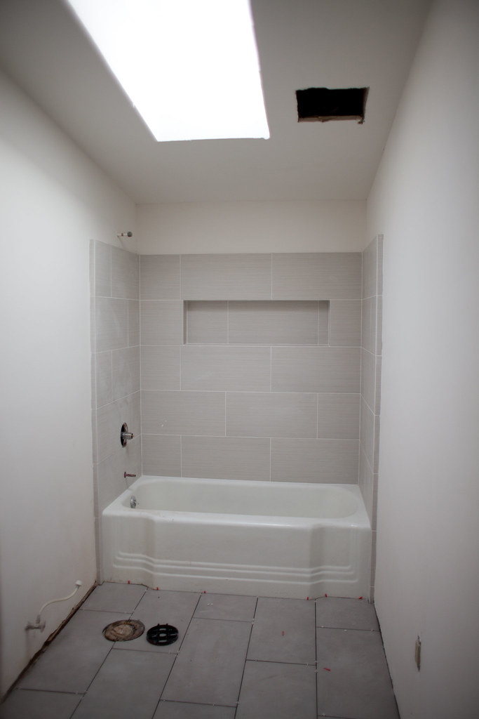 Hall bath with new tile