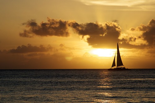 sunset sea seascape water silhouette clouds boat barbados