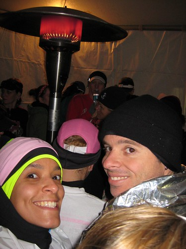 Huddled around space heater for warmth in Galloway tent before race start