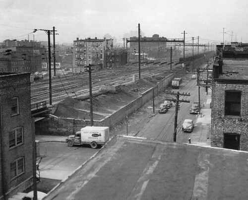 The Pennsylvania Railroad's Harsimus Stem Embankment which people are now trying to save as a linear park looked mercilessly bleak in 1951. Looking west at 6th Street. Jersey City.