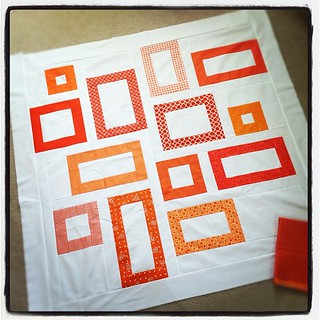 My Tangerine Tango quilt top - debating adding 2 more borders to make it bigger?