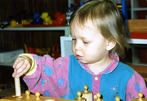 My daughter, Christina, at age 1½ working with a Montessori cylinder block, 1992.