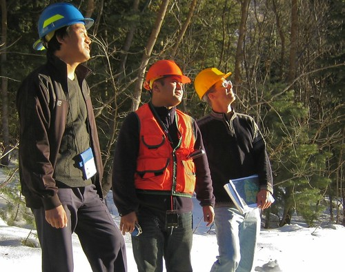 Kevin Megown (right), program manager at the Remote Sensing Applications Center in Salt Lake City, familiarizes Phub Dhendup (left) and Kinley Tshering (center) with the forest types found in the montane, basin and range ecosystems in Mill Creek Canyon on the Uinta-Wasatch-Cache National Forest in Utah. Dhendup and Tshering are official guests of the U.S. Department of State and the U.S. Forest Service, and are assigned to the Department of Forests, Ministry of Agriculture and Forests in Bhutan. They are spending two combined months in Salt Lake City and Missoula, Mont. while working and training with the Forest Service on forestry and climate change issues.