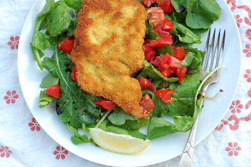 Chicken Milanese over a bed of fresh arugula with tomato by Eve Fox ...