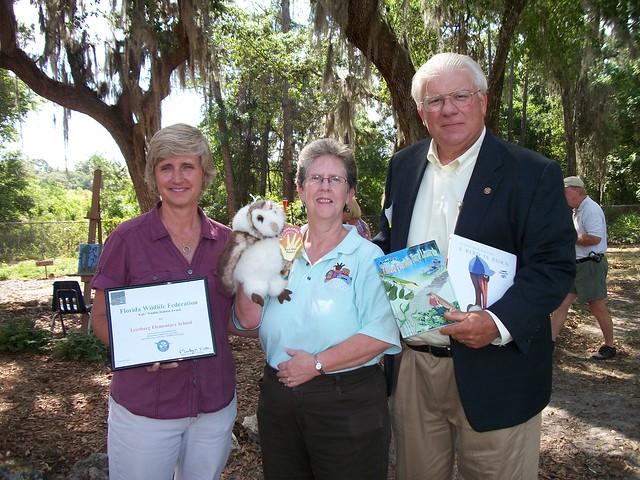 Left to right: Lesa Roe, Science/Math Enrichment Teacher, Julie Sligh, School Librarian, Dr. George Tanner, Director, Florida Wildlife Federation