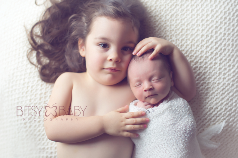 newborn with sibling