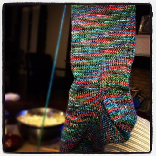 My #oscar  #knitting A sock out of Destination Yarn in the charted cathedral color way.