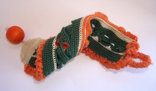 Green, orange and a touch of beige freeform bracelet