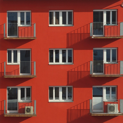 windows red sun building shadows details balconies innsbruck vanagram blinkagain