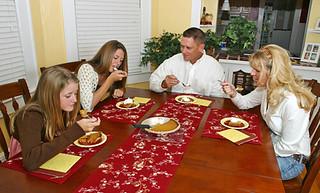 ESL student having dinner with homestay family
