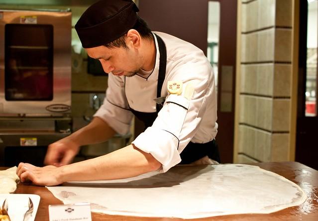 John Chang preparing roti