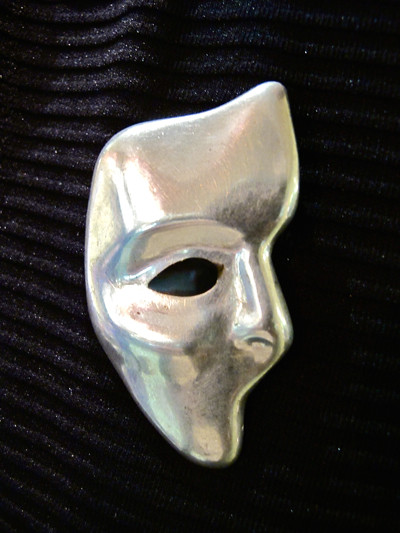 Get mysterious with this Mexican silver face mask brooch