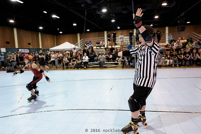Killa Kee is pointing at the lead jammer who has just scored five points