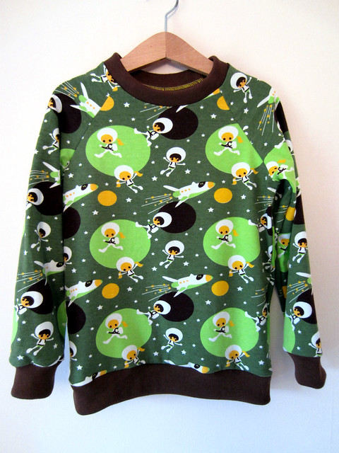 green astronaut top