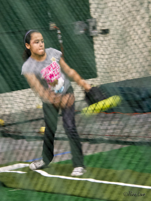 Triple Play batting cages - girl pitching