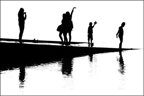 Silhouettes on the jetty
