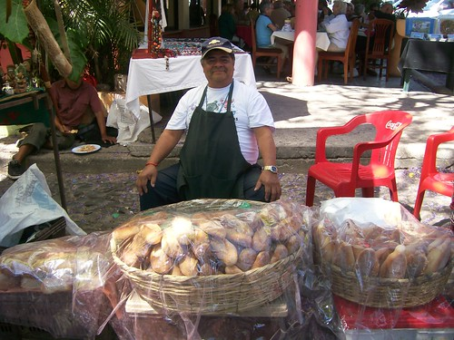 Proud vendor of fresh bread at Ajijic street market by klsterndahl