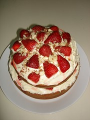 strawberry pie(0.0), produce(0.0), torte(0.0), pavlova(1.0), cake(1.0), strawberry(1.0), baked goods(1.0), whipped cream(1.0), food(1.0), icing(1.0), dish(1.0), dessert(1.0), cuisine(1.0), mascarpone(1.0),