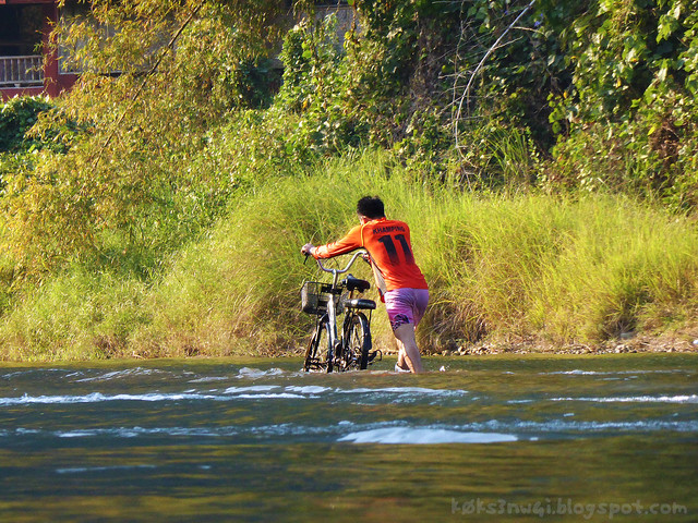 Vang Vieng Tubing 10 Crossing Nam Song with a Bicycle