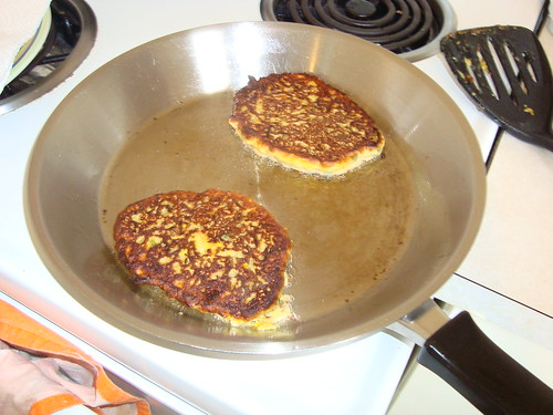 The fritters, already cooked on one side are being cooked on the other side