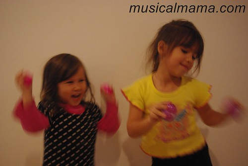 girls dancing with home-made egg shakers