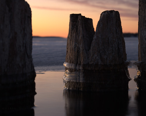 winter sunset ice nikon michigan north pilings goldenhour boynecity lakecharlevoix d60