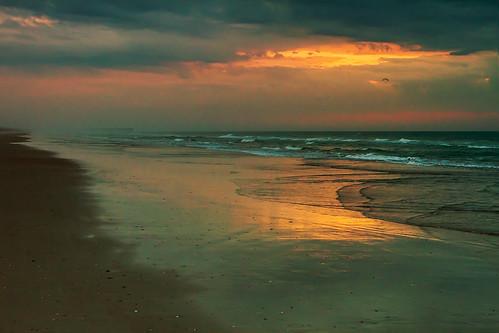 rain sunrise day northcarolina topsailisland topsailbeach jollyrogerpier