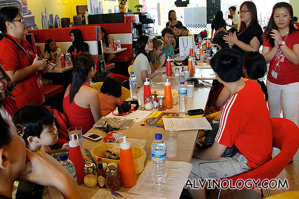 Bloggers briefing by Angela (standing, in black top) from Far East