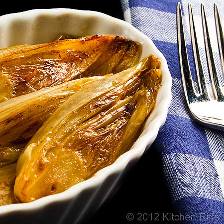 Braised Belgian Endive in oblong White Ramekin with Fork