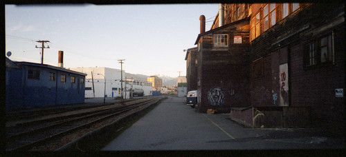 auto street railroad winter light sunset sky panorama canada color colour art industry film face lines architecture vancouver analog train 35mm poster point graffiti official lomography focus chinatown track shoot artist industrial shadows bc natural pentax tag grain wide tracks mini columbia panoramic scan east negative automatic area rails british strathcona 135 van february feb pocket studios evidence parker compact 2012 espio unbranded sooc