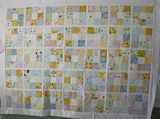 It's a simple, sweet quilt. I love that I had almost every fabric needed already on-hand. The backing fabric has arrived, so as soon as I tidy off my table, pinning and quilting shall begin.  I really need to do a writeup on this quilt, but ... I don't want to until I can say who it's for. :)