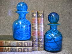 perfume(0.0), purple(0.0), glass bottle(0.0), drinkware(0.0), bottle(0.0), glass(0.0), vase(0.0), cosmetics(0.0), aqua(1.0), turquoise(1.0), cobalt blue(1.0), teal(1.0), azure(1.0), blue(1.0),