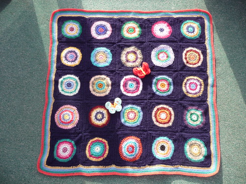 This is a gorgeous Blanket. Circles within Squares! Beautiful colours and so kind of you thank you joyce28!
