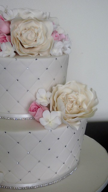 Pink, ivory, bling wedding cake