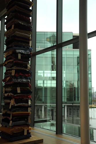 Stack of blankets and their stories, sculpture, Space Needle reflection, glass and steel building, Bill & Melinda Gates Foundation, Seattle, Washington, USA by Wonderlane